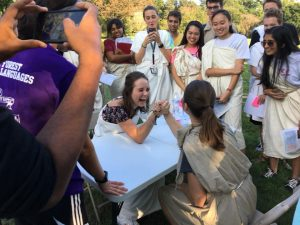 Students arm wrestle for the Ancient Olympics