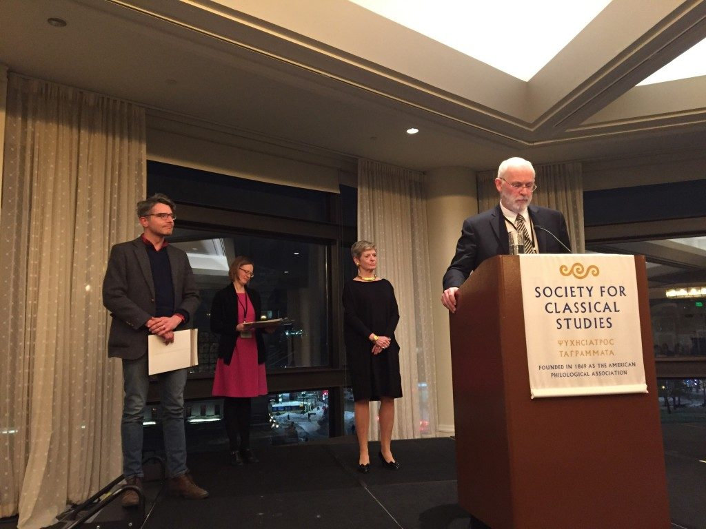 John Oksanish accepting Mary Pendergraft's award on her behalf